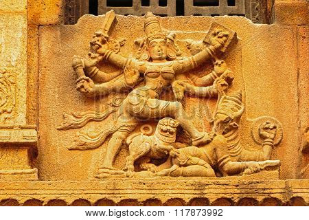 Statue of Goddess Durga devi in action on Mahisasura depicted on the walls of temple
