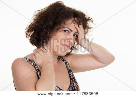 Woman Having A Headache Caused By Stress And Tension