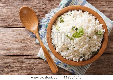 Cauliflower Rice With Basil In A Bowl Close-up. Horizontal Top View