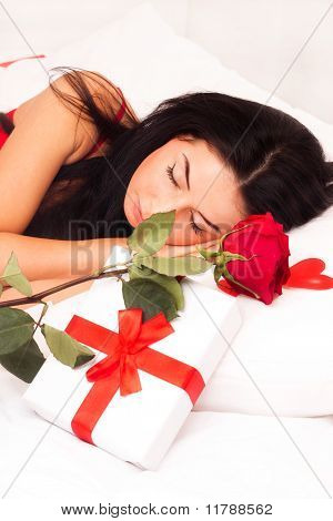 In Love With A Beautiful Young Girl Lying In Bed, Strewn With Hearts And Roses. Feast Day Of St. Val