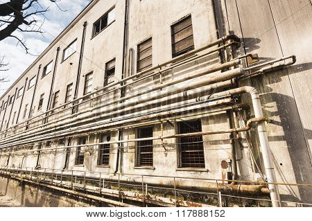 Old Factory And Pipes