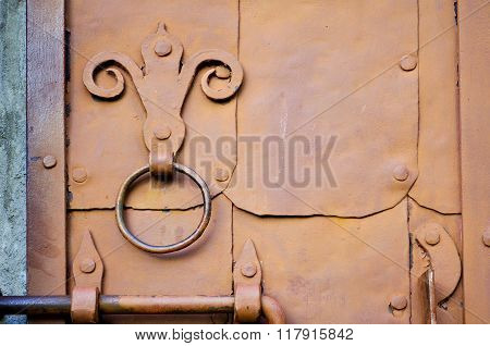 Industrial Textured Background - Old Brown Door With Rivets And Aged Metal Door Handle In The Form O