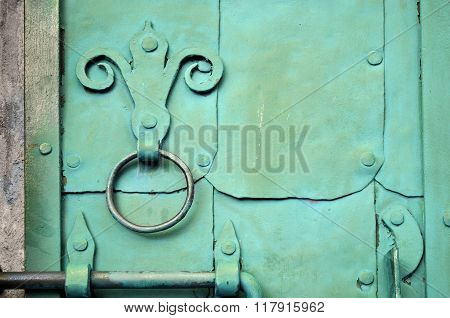 Industrial Textured Background - Old Green Door With Rivets And Aged Metal Door Handle In The Form O