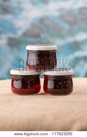 Three Jam Jars With Cones
