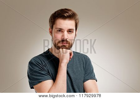 Portrait Of Seriously Young Man With Beard