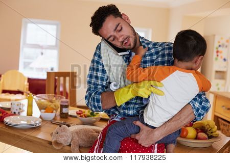 Busy Father Looking After Son Whilst Doing Household Chores poster