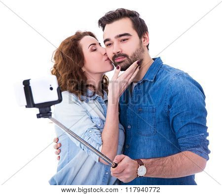 Young Couple Taking Selfie Photo With Smart Phone Isolated On White