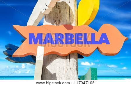 Marbella welcome sign with beach