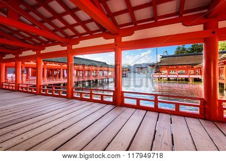 HIROSHIMA, JAPAN - DECEMBER 3, 2015: The open air halls of Itsukushima Shrine on Miyajima Island. The shrine is known for the famous floating torii gate.
