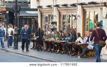 LONDON, Typical London's public house with people having a rest