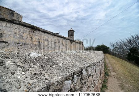 Wall Of An Ancient Fortress Under Tragic Cloudy Sky