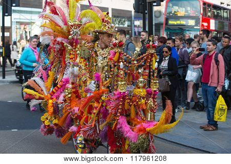 Decorated bike rider performing his outfit at Regent street