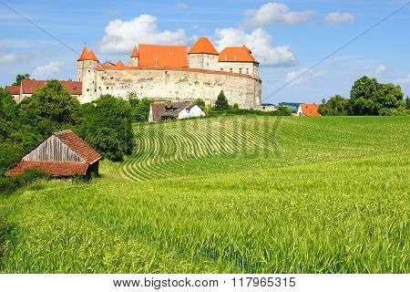 Picturesque landscape with castle Harburg.