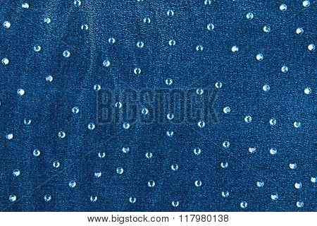 Abstract Background With Blue Rhinestones On Denim