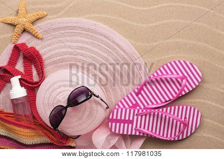 Accessories For The Beach Lying On The Sand Beach