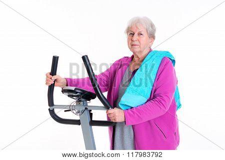 Female Senior Train With Fitness Machine