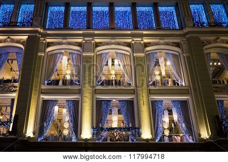 Facade with many windows and christmas decoration.