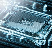 CPU socket on the motherboard. focus on CPU socket. toned image poster