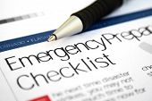 Close up of pen on emergency checklist poster
