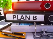Plan B - Black Ring Binder on Office Desktop with Office Supplies and Modern Laptop. Plan B Business Concept on Blurred Background. Plan B - Toned Illustration. 3D Render. poster