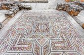 Complex and elaborate Roman tessera mosaic pavement in the House of the Swastika. Conimbriga in Portugal, is one of the best preserved Roman cities on the west of the empire. poster