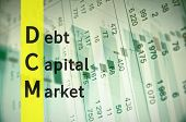 Acronym DCM as Debt Capital Market. The financial data visible in the background. poster