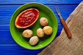 Papas arrugas al mojo wrinkled potatoes Canary islands recipe red spicy sauce poster