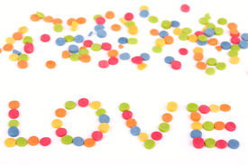 Multi colored love note written by candy