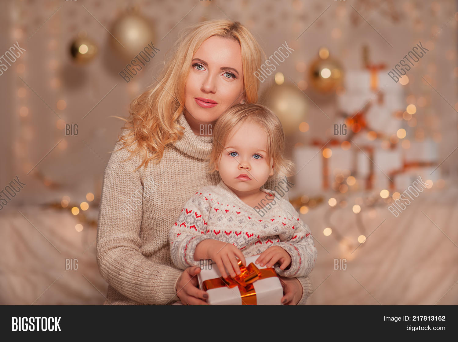 Merry Christmas And Happy New Year Family Mom Little Daughter Sitting Indoor At