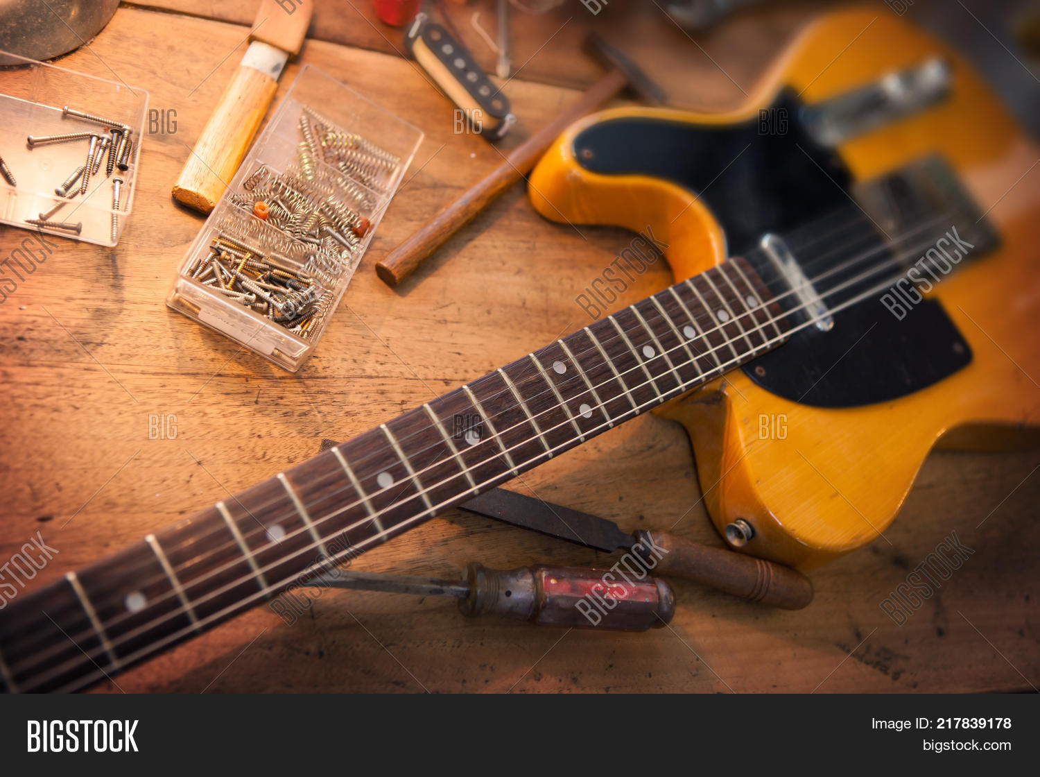 guitar repair image photo free trial bigstock. Black Bedroom Furniture Sets. Home Design Ideas