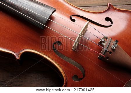 Close up of Classic Violin on Wood Background