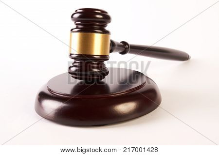Judges gavel or law mallet and sound block isolated on white background, close-up. Judgement or auction and conceptual of justice and judgements poster