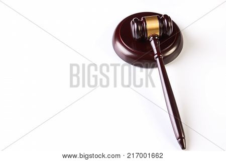 Judge's Gavel over white background with copy space. Wooden judgement hammer or mallet isolated on white, close-up. Legal law legislation concept, top view