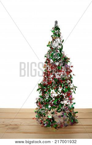 Mini Christmas Tree on a Wooden Background