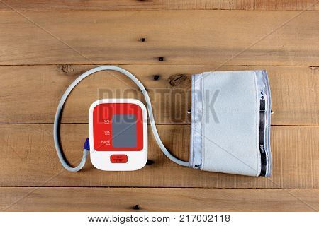 Blood Pressure Monitor on a Wooden Background