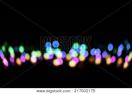String of Fairy Lights on Black Background