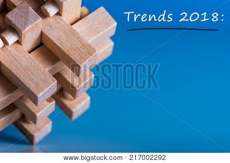 2018 new year TRENDS. New trend at business innovation technology and other areas. Blue background with macro view of brain teaser and empty space for text, Mockup.