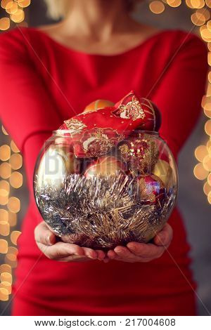 Girl holding a Christmas tree toy. Christmas holiday concept. Holiday background