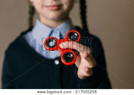 Little girl playing with a fidget spinner