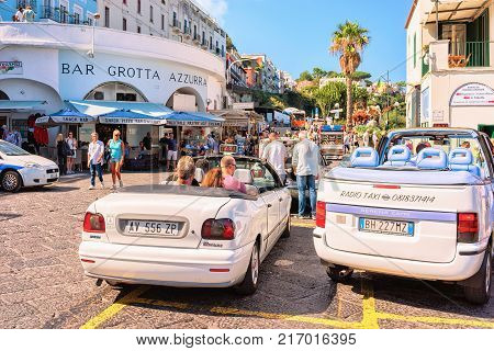 Capri Italy - October 3 2017: Tourists at typical taxi cars on Capri Island Italy