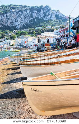 Capri Italy - October 3 2017: Boats on Marina Grande embankment in Capri Island in Tyrrhenian sea Italy