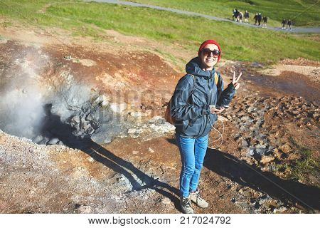woman traveler on a walk in the Valley of the river of Hveragerdi Iceland. Hiking Tour of Reykjadalur Hot Springs