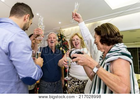 Family making a toast (champagne) for the new year coming