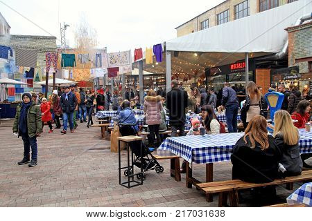 KIEV, UKRAINE - NOVEMBER 4, 2017: Unidentified people relax and eat local food in outdoor Street Food Festival in Kiev, Ukraine.