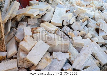 Pieces of onyx rock cut for further processing of material for the manufacture of decorative figurines