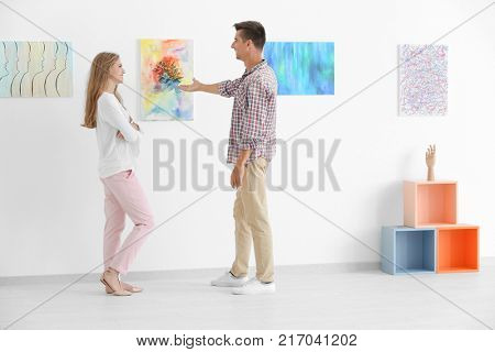 Young couple in art gallery