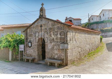 PONTEVEDRA, SPAIN - SEPTEMBER 8, 2017: Old Saint Marta Chapel close to Pontevedra on the Camino de Santiago trail on September 8, 2017 in Spain