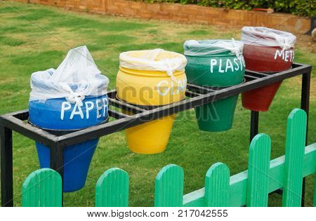 Different colorful trash bins outdoors. Recycling concept