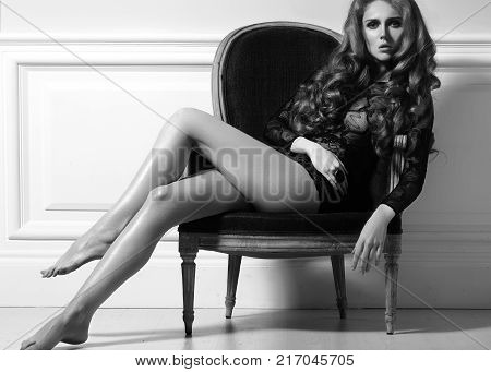Beautiful Luxury Woman Model Posing In Black Lacy Dress In Rertro Chair. Beautiful Portrait In Inter