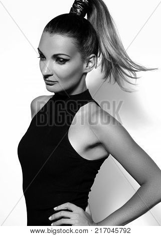 Fashion portrait of beautiful young woman with ponytail hairstyle. Beauty shot of sexy girl on white background. Pony tail straight hair catwalk black eyeliner makeup on model face poster